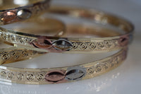 Tricolor Gold Plated 7 Bangle Set With A Marquise Design