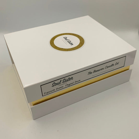 White and gold gift box, magnetic side closure with business identification script along side, cursive font with Business name and Set name