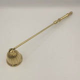 Brass candle snuffer with ridged bell and turned and elevated brass rings, turned handle