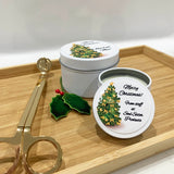 White candle tins with Christmas Tree design labels