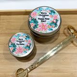 Gold Christmas candle tins with colourful Christmas wreath design personalised label and gold wick trimmers
