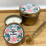 Gold Christmas candle tins with colourful wreath design personalised label and gold wick trimmers