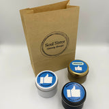 Three candles in black, white and gold tins with Facebook 'like' emoji label design. Personalised corporate promotion candles and kraft bag with Soul Sister Products stamped design