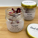 2 jars of foot soak salts with essential oils and rose petals with lavender buds