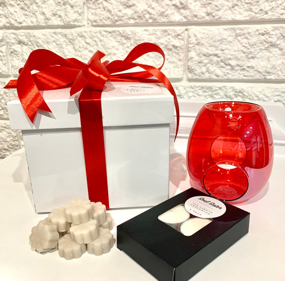 White box red ribboned red melt burner and black box tea light candles with wax melt shapes