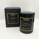 Black candle with gold lettering and black label with black carry box