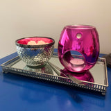Metallic pink and silver outer wax melt storage bowl, metallic pink melt or oil burner, on a silver decorative tray