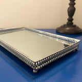 Decorative and silver trimmed mirrored silver tray ornate with silver feet square
