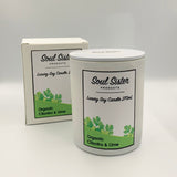 White gloss candle with black text and green foliage label. White labelled box.
