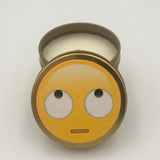 Gold emoji candle with rolling eyes symbol