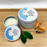 White Christmas candle tins with a cute peeking Santa design label in two size tins