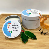 White Christmas candle tins with cute Santa label design and personalised text