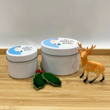 White Christmas candle tins with a cute Santa label design and personalisation options in two size tins
