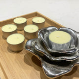 Tea light candles in lemon pastel yellow with silver candle holder display