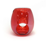 vibrant red transparent melt burner or oil burner with opening at base for the tea light candle and a bowl at the top