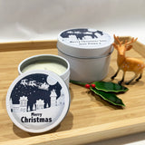 White Christmas candle tins with Santa Sleigh label design and personalised text