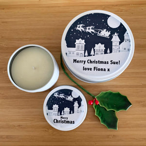White Christmas candle tins with Santa Sleigh on Christmas Eve label design and personalised text
