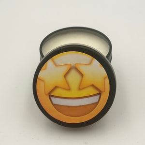 Starry eyes emoji yellow in a matte black small candle