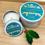 White Christmas candle tins with teal and gold Christmas label design and personalised text, large and small tins