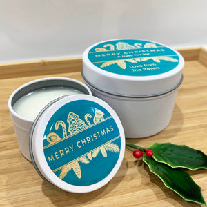 White Christmas candle tins with teal and gold Christmas ornament design large and small