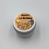 Personalised white party favour candle with orange children's theme label, teddy bears and balloons 1st birthday