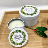 Holly wreath label designs with personalised text on white Christmas candle tins