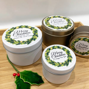 Christmas fir wreath label designs with personalised text on white background, white and gold Christmas candle tins