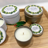 Gold and white Christmas candle tins with holly wreath label designs with personalised text