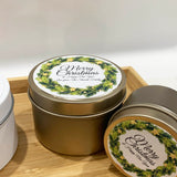 Gold Christmas candle tins with holly Christmas wreath label design and personalised text