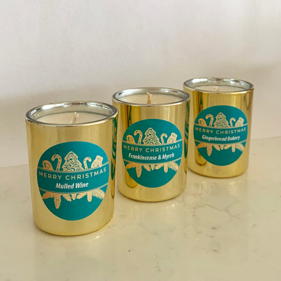 Three mini gold Christmas candles