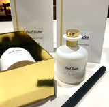 White and gold luxury gift boxes for white glass reed diffuser with gold accents. Black Orchid Musk fragrance