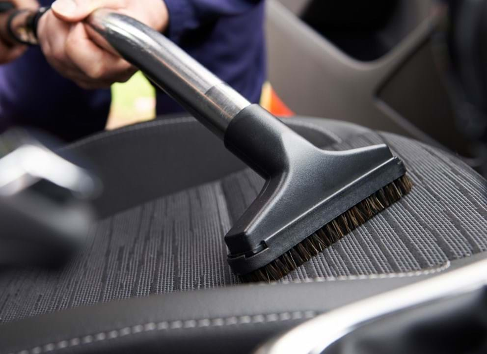 how-to remove cigarette smell from your car - turtle wax - vacuum car upholstery