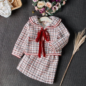 Fabulous tweed jacket and skirt set, with ribbon bow.