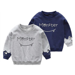 Boys grey monster jumper.