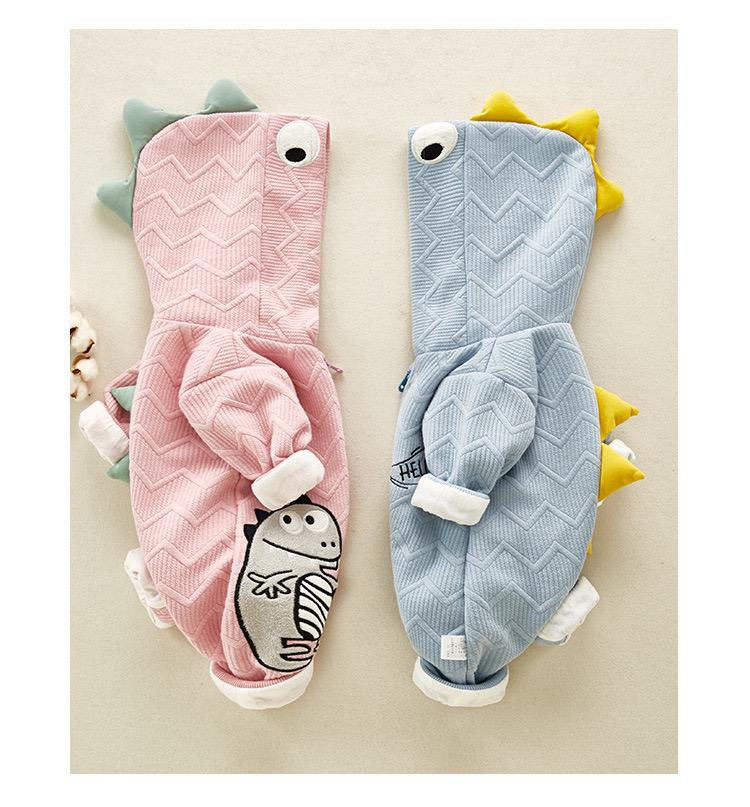 Boy and girl newborn dinosaur onesies