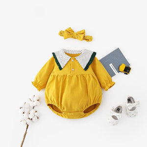 Cute collared baby romper with matching headband.