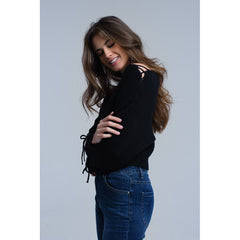 Black crop sweater with tie ribbons