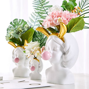 Girl With Bubble Gum Flower Arrangement Vase