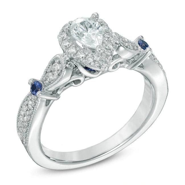 5/8 CT. T.W. Pear-Shaped Mozambique Diamond and Blue Sapphire Vintage-Style Ring in 925 sterling silver