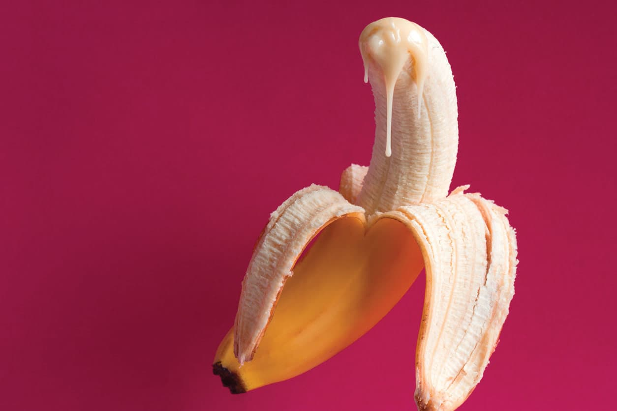 Banana with cream on tip simulating cum