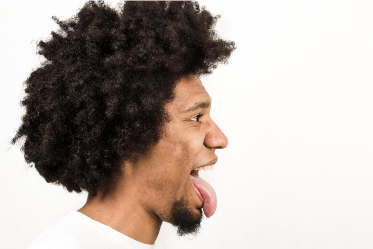 Man with his tongue out symbolizing cunnilingus tips and techniques for men