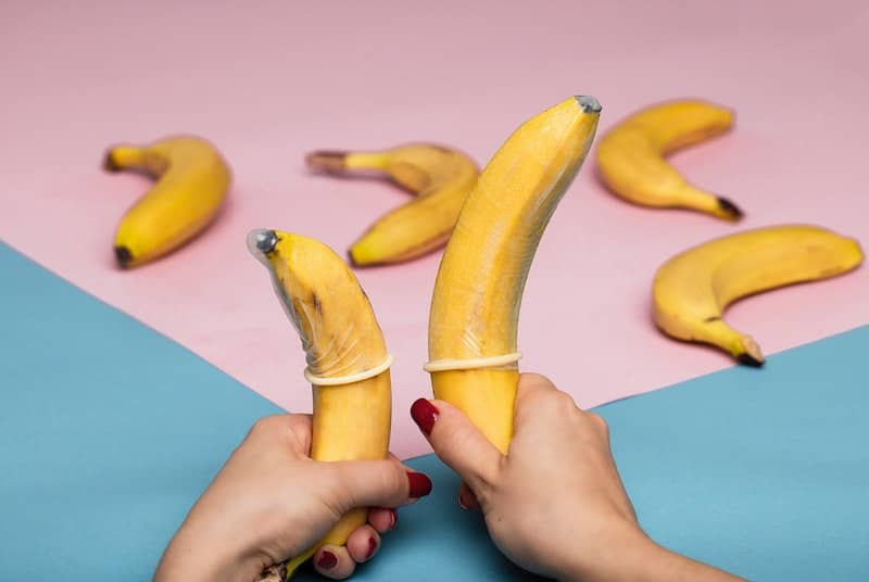2 bananas with condoms on promoting safe sex during pegging