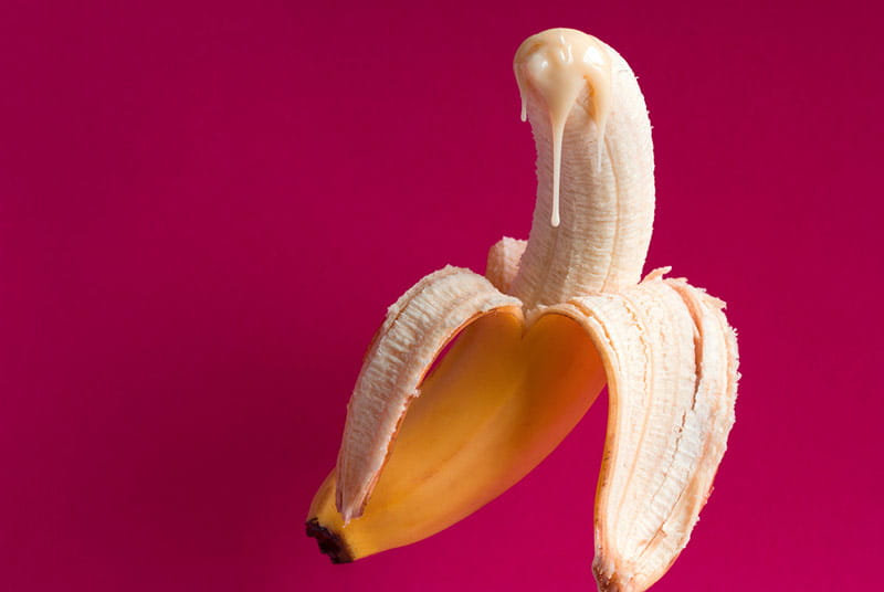 Banana with cream on the tip resembling premature ejaculation
