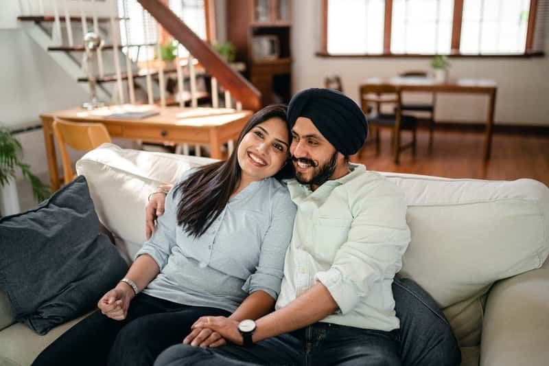 Couple on couch happy they got a penis sleeve