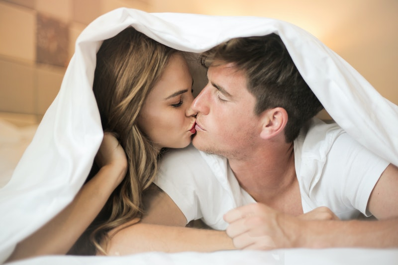 Couple kissing and getting ready to use sex lube