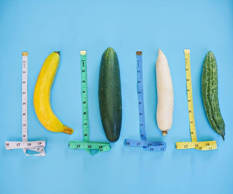 Four penis shaped fruits being measured next to each other