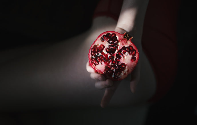 Woman holding pomegranate