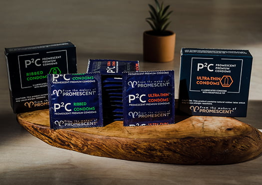 Promescent premium ribbed and ultra thin condoms on display in a lifestyle image.