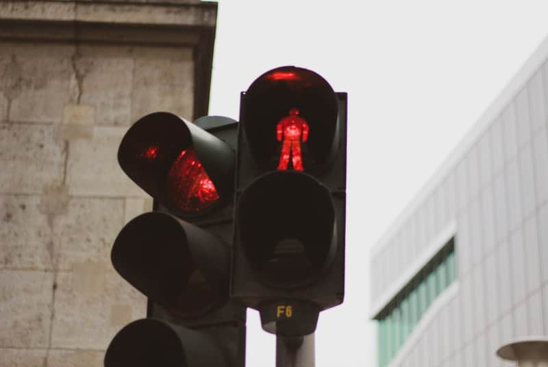 Red light with man stopping indicator symbolizing stopping to delay ejaculation