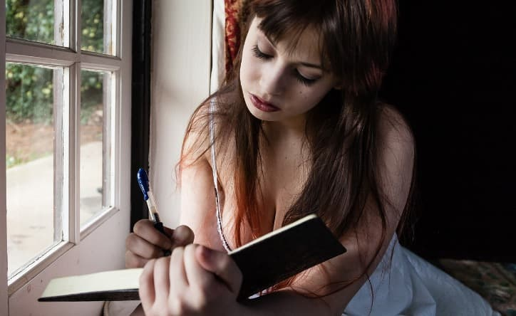Woman Keeping a Diary of Her Sexual Fantasies